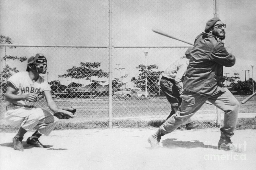 Fidel Castro Swinging Baseball Bat Photograph by Bettmann