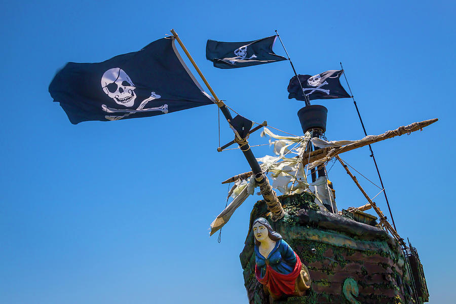 Flags Photograph - Figurehead On Black Flag Pirate Ship by Garry Gay