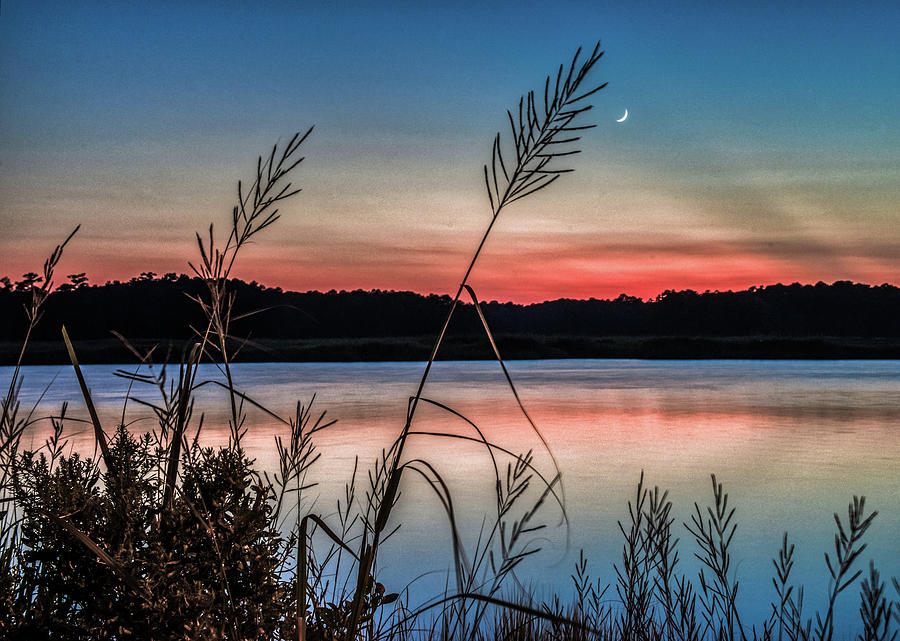 Fingernail Moon at Sunset by Jerry Gammon