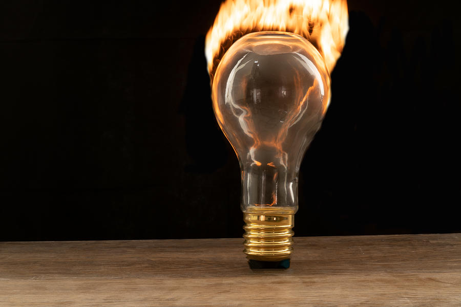 Fire and flames ignited out of light bulb by Vincent Billotto