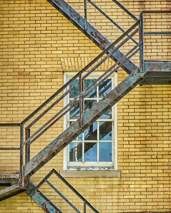 Fire Escape On Colorful Brick Wall by Gary Slawsky