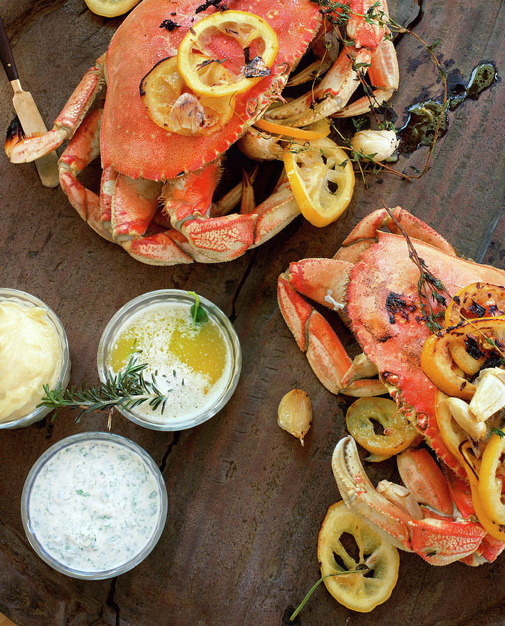 Fire Roasted Dungeness Crabs On Wooden Photograph by Lisa Romerein