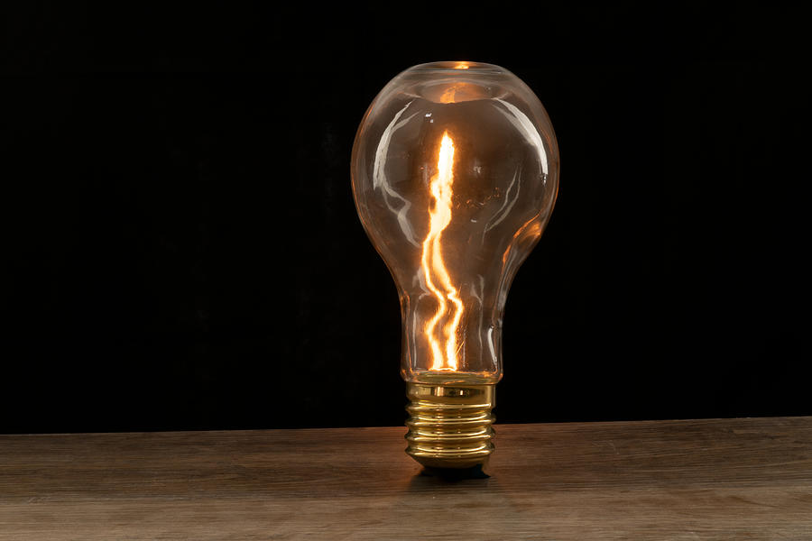 Fire sparks inside a light bulb by Vincent Billotto