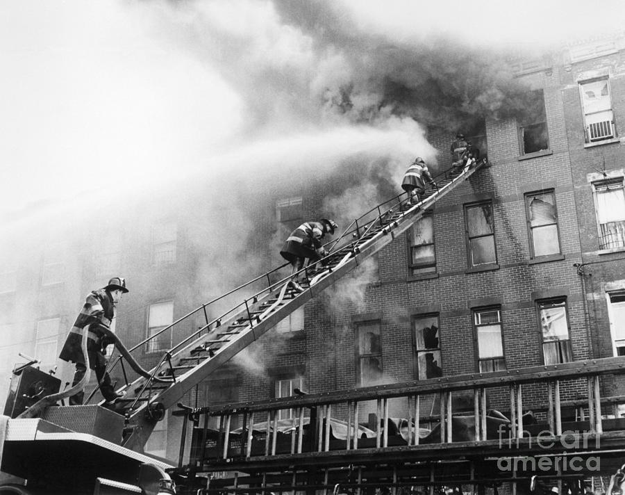 Firefighters Fight Apartment Blaze Photograph by Bettmann