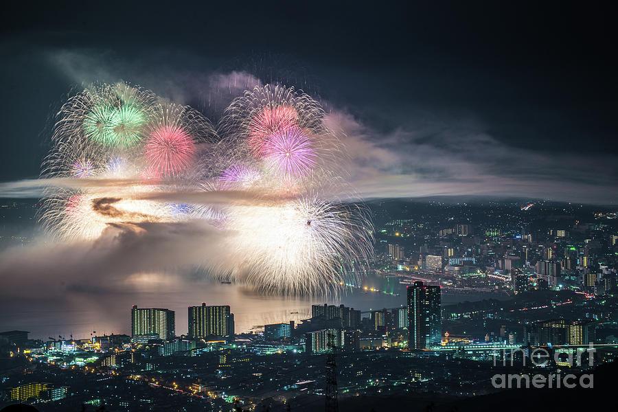 Fireworks Display Over City At Night Photograph by Yuttakon Yuttakonkit