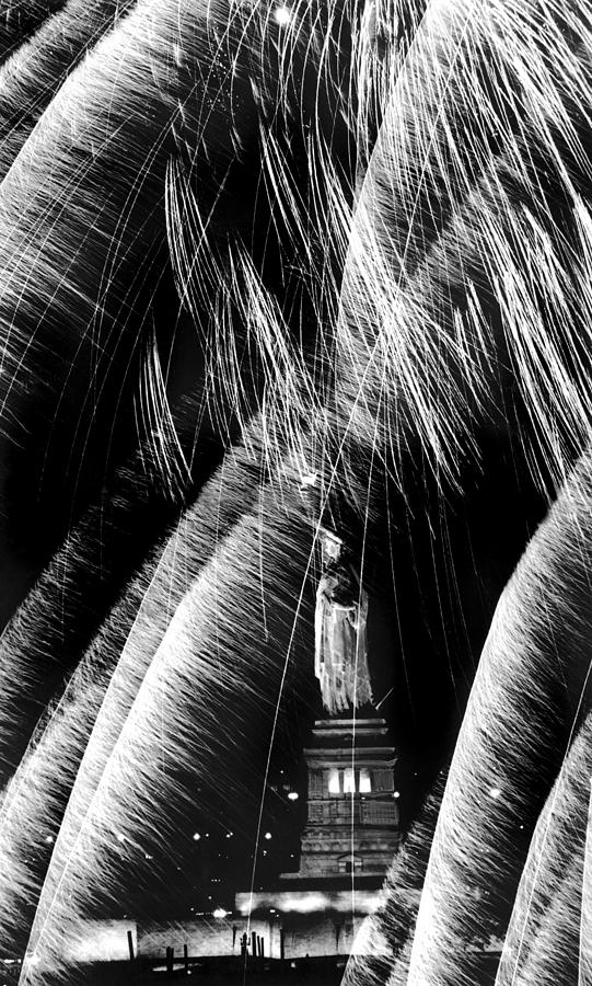 Fireworks Explode Around Statue Of Photograph by New York Daily News Archive