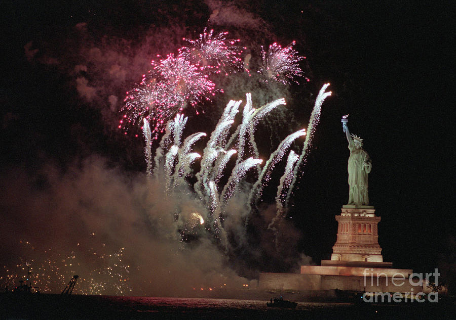Fireworks Exploding Near Statue Photograph by Bettmann