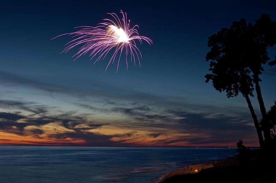 Fireworks On A Beach At Sunset Photograph by Bradwieland
