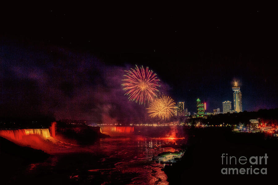Fireworks over the falls. by Jim Lepard