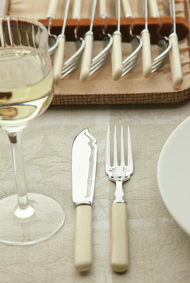 Fish Knife And Fork Set At Table Setting Photograph by Bill Boch