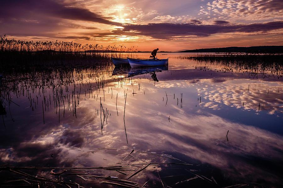 Fisherman on the boat by Okan YILMAZ