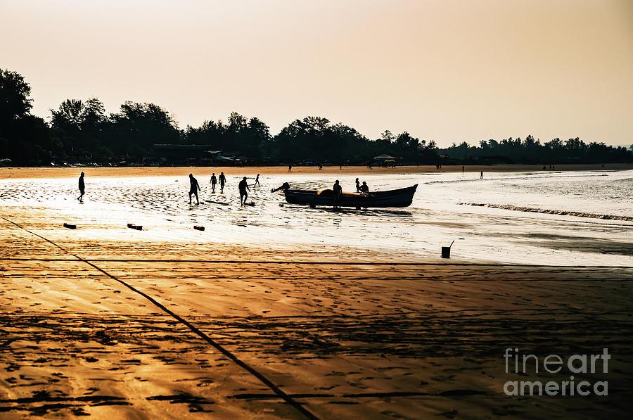 Fishermen at Morjim Beach by Miles Whittingham