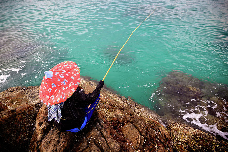 Fishing At Rocky Beach Photograph by Fredfroese