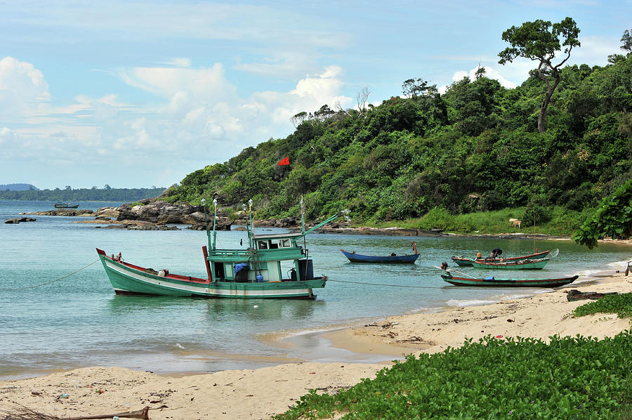 Fishing Boats In Cove And Beach Photograph by Christophe cerisier