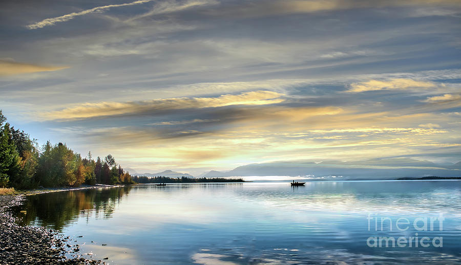 Fishing on an Alaskan lake on the Kenai peninsula at sunrise by Patrick Wolf