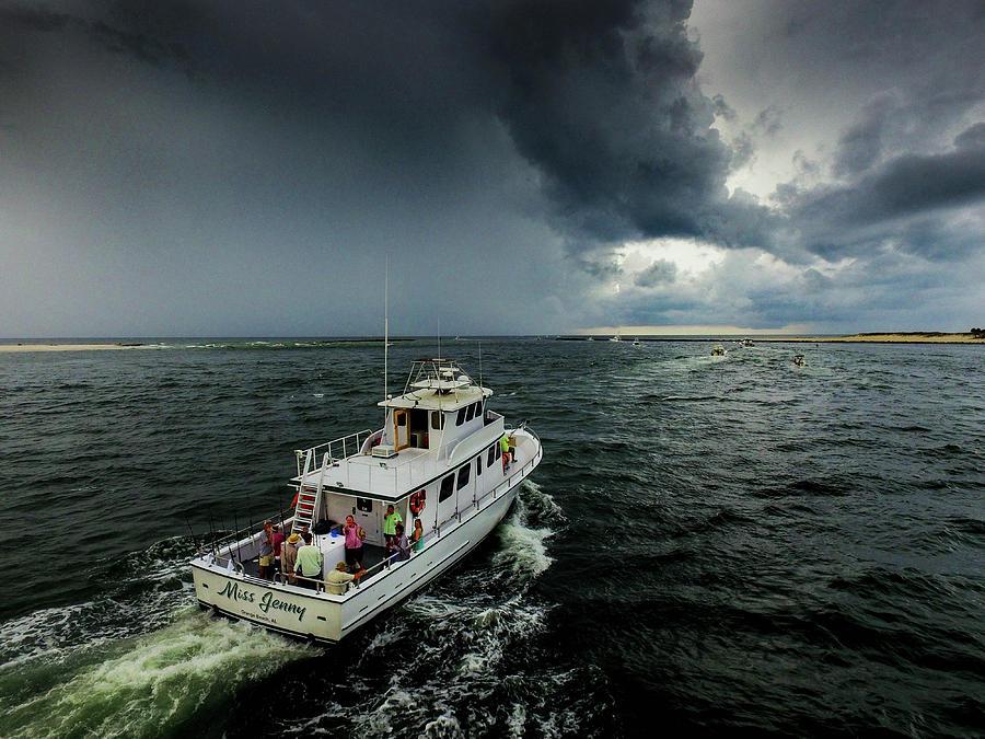 Fishing on Miss Jenny Rain or Shine by Michael Thomas