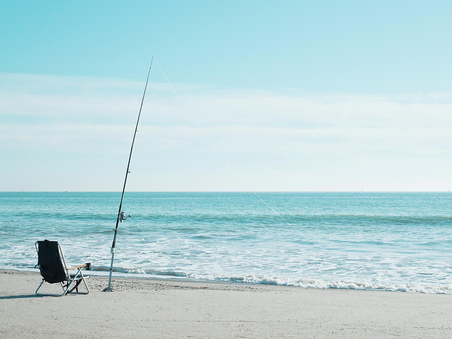 Fishing On The Beach Photograph by Jp Greenwood