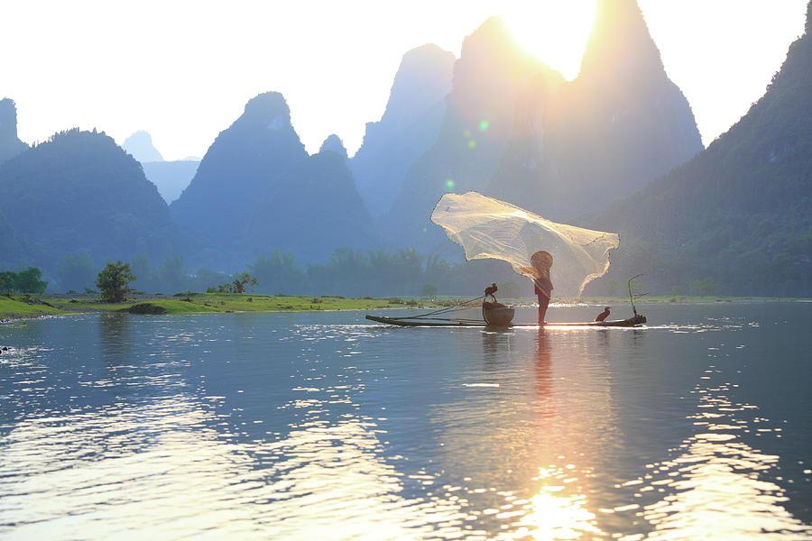 Fishing On The Li River Photograph by Bihaibo