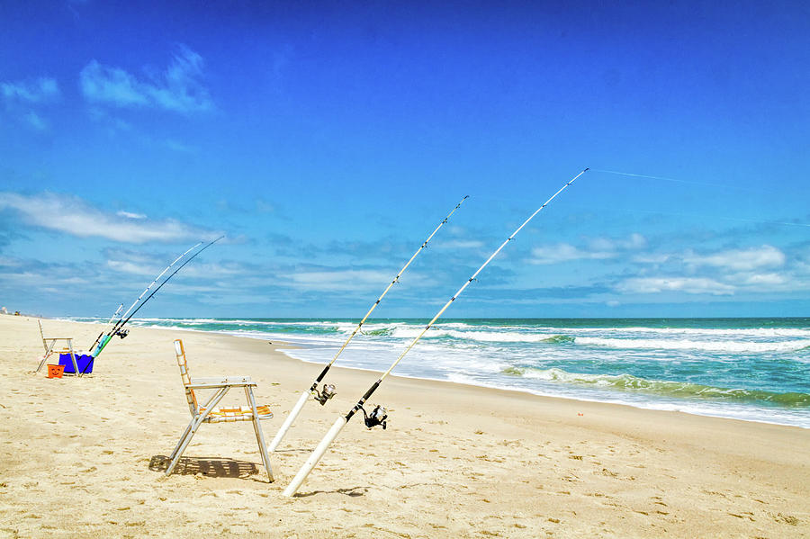 Fishing Poles On A Beach Photograph by Kayla Stevenson Photography