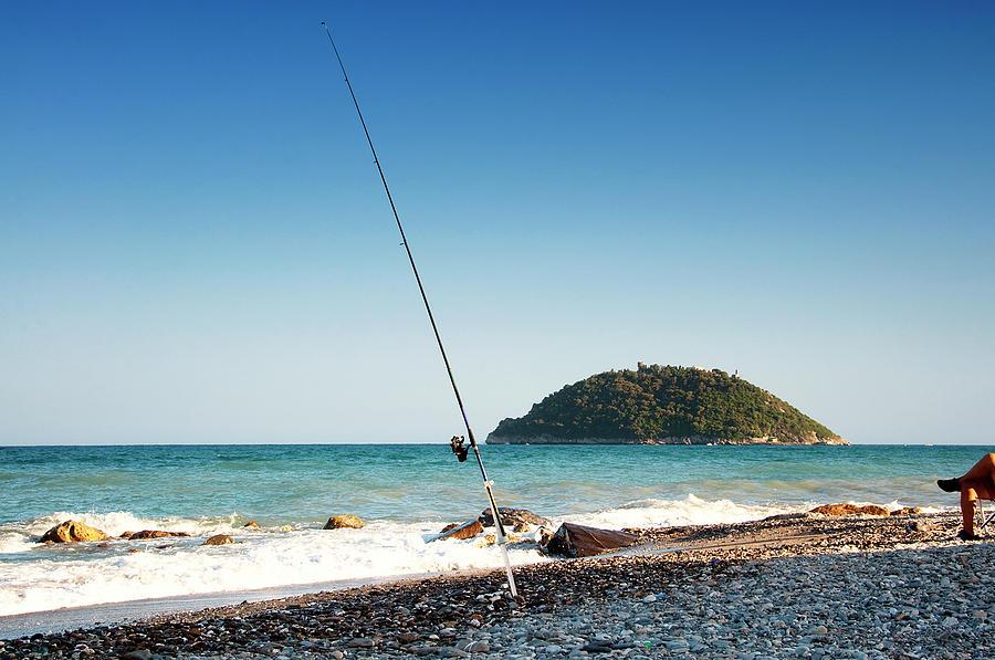 Fishing Rod, Gallinara Island In Photograph by Sebastian Condrea