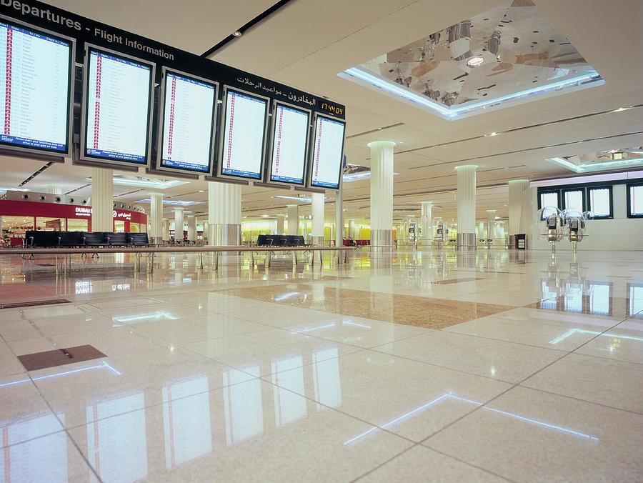 Flight Information Displays At Dubai Photograph by Eschcollection