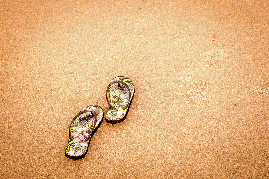 Flip-Flops On The Sand. by Jeff Sinon