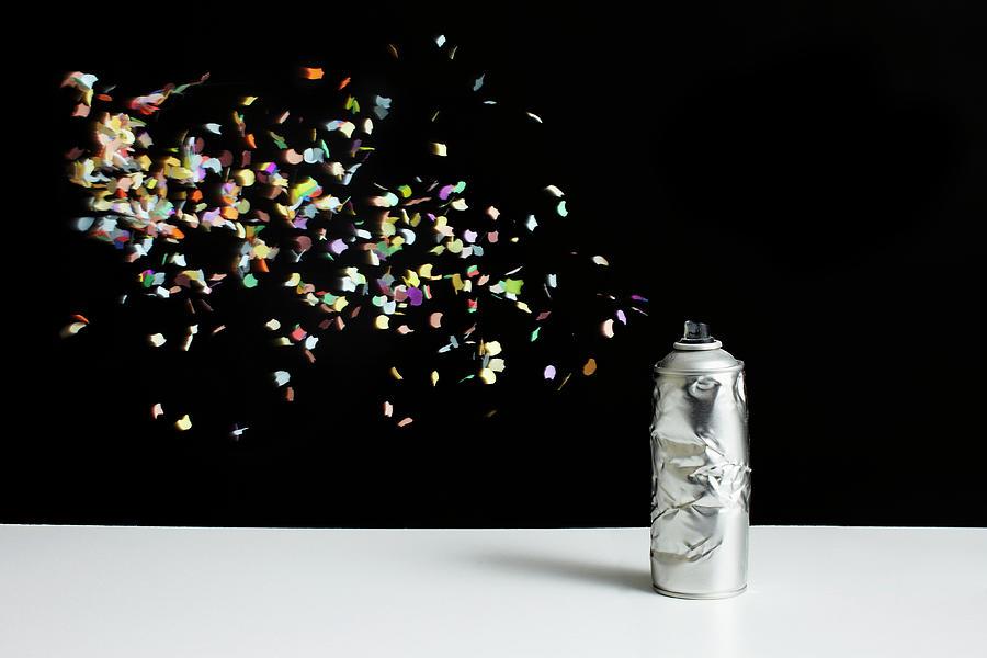 Floating Confetti And A Damaged Spray Photograph by Benne Ochs