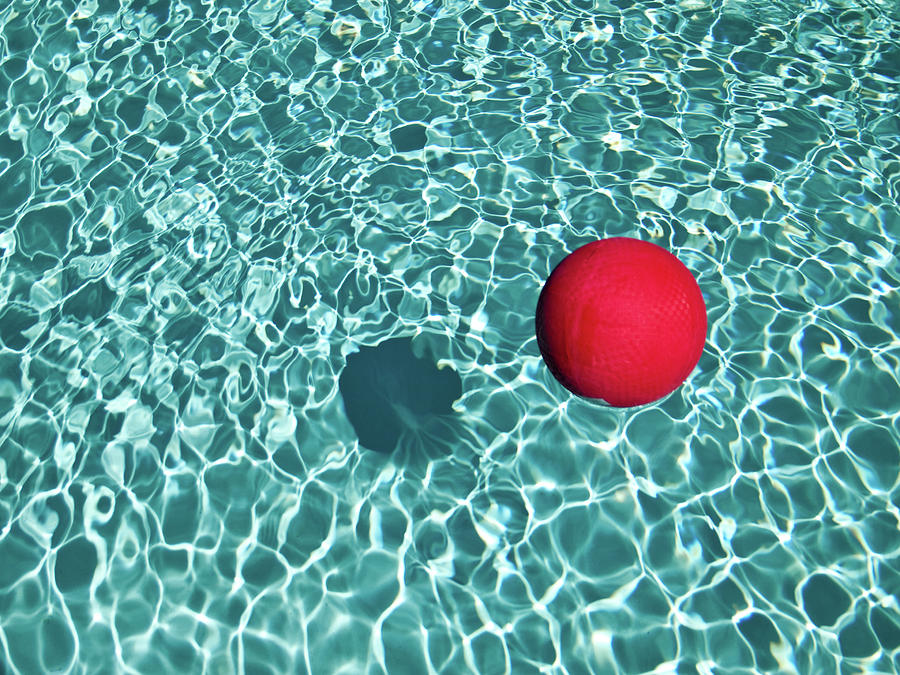 Tranquility Photograph - Floating Red Ball In Blue Rippled Water by Mark A Paulda