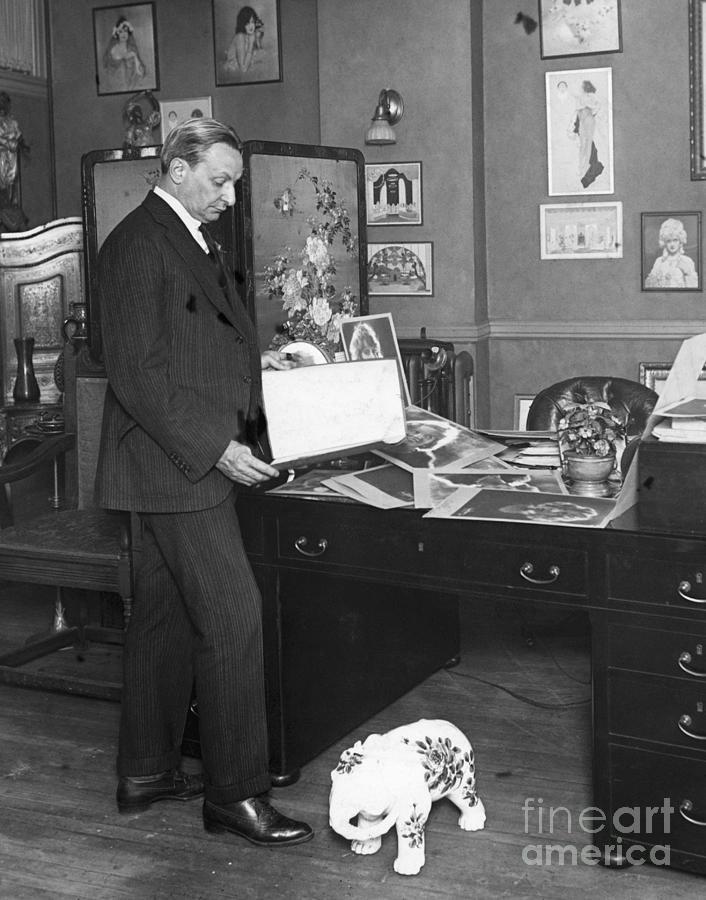 Florenz Ziegfeld Looking At Photographs Photograph by Bettmann