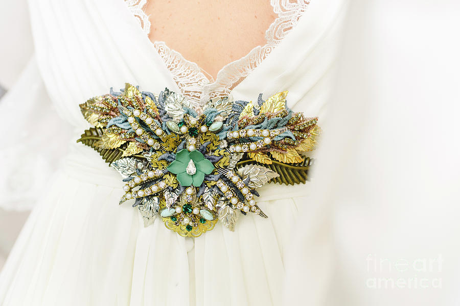 Flower shaped brooch made with small gemstones for a wedding dre by Joaquin Corbalan