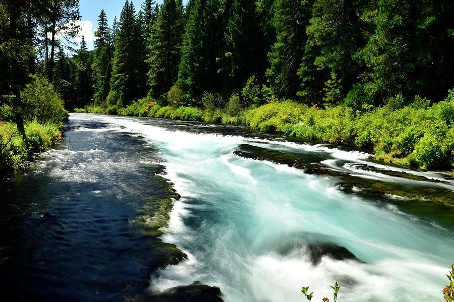 Flowing Metolius River by Jerry Sodorff