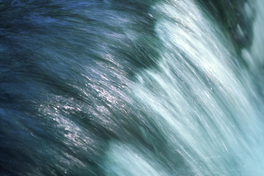 Flowing Water Photograph by Ooyoo