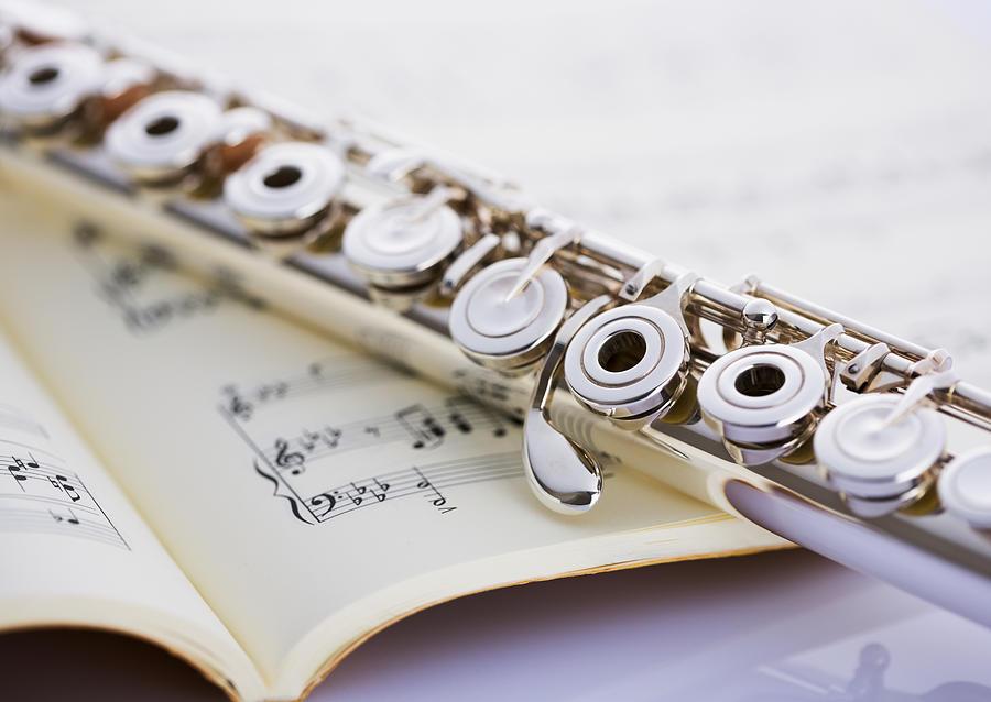 Flute On A Score Photograph by Imagenavi