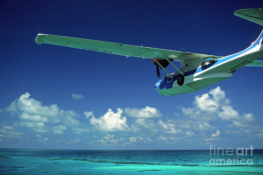 Caribbean Seascape Photograph - Fly away to another World by Hans Wiesman