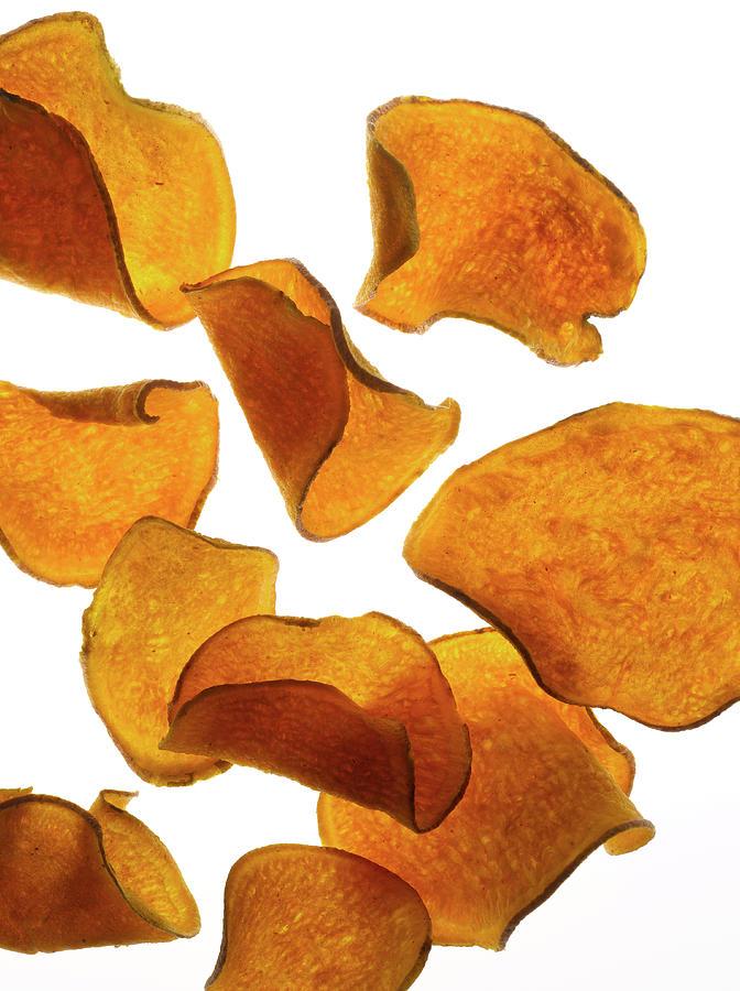 Flying Sweet Potato Chips Photograph by Howard Bjornson