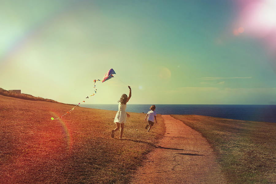Flying The Kite Photograph by Carol Yepes