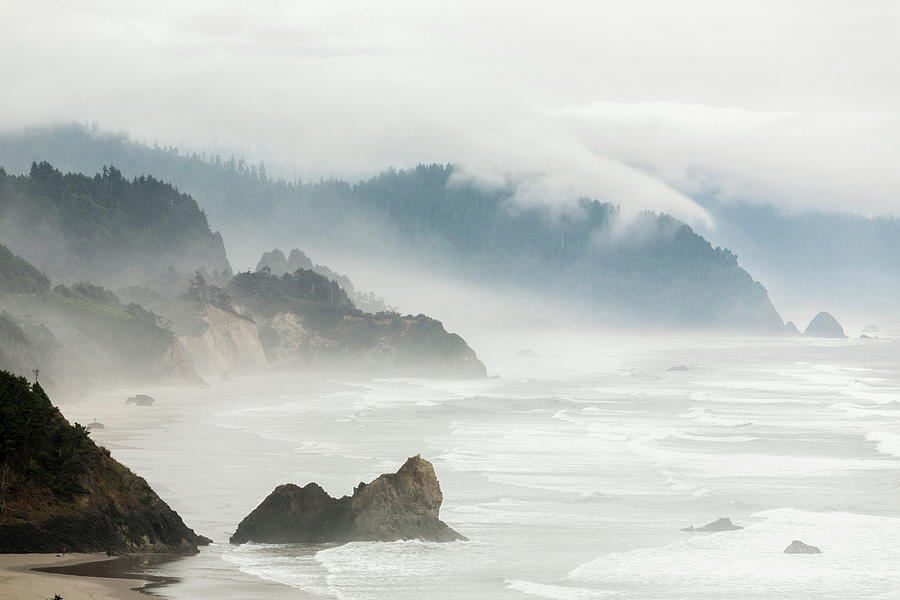 Fog Shrouded View Of Rocky Coastline Photograph by Win-initiative