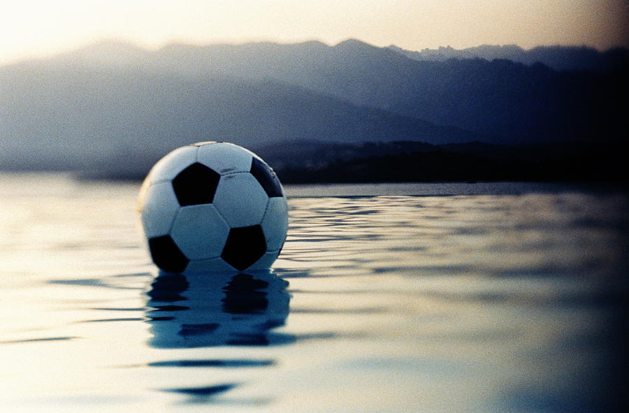 Football Floating In Water Photograph by Ghislain & Marie David De Lossy