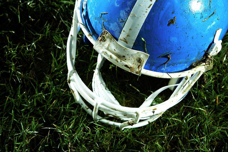 Football Helmet On Grass Photograph by Thomas Northcut