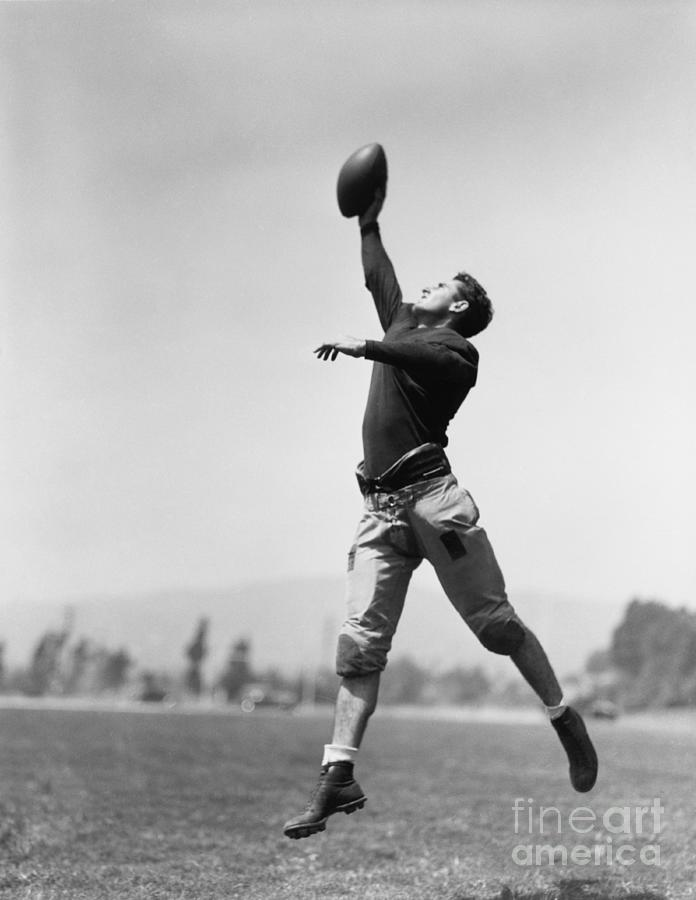 Play Photograph - Football Player Catching Ball by Everett Collection