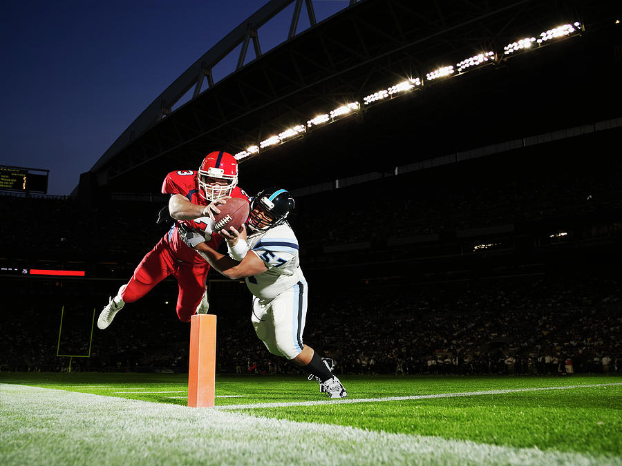 Football Player Diving Into End Zone Photograph by Thomas Barwick