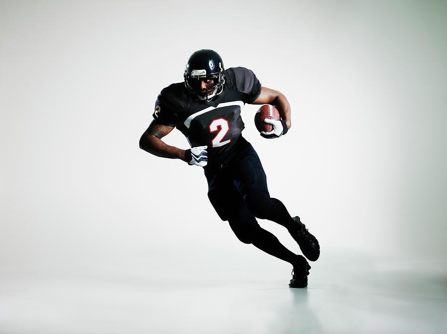 Football Player Running With Ball Photograph by Thomas Barwick