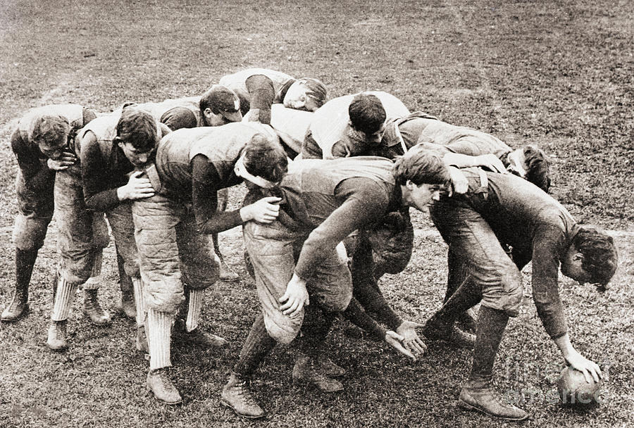 Football Players In Flying Wedge Photograph by Bettmann