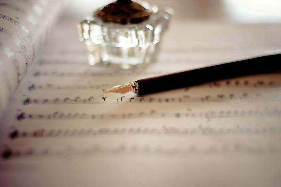 Fountain Pen Atop Sheet Music Photograph by Nico De Pasquale Photography