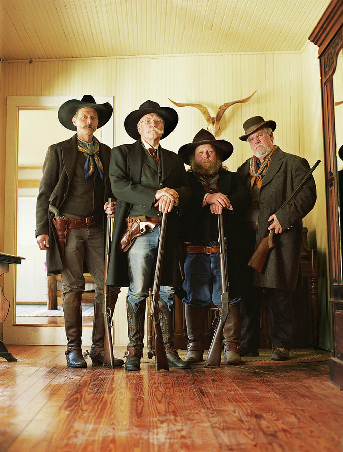 Four Cowboys With Rifles And Revolvers Photograph by David Sacks