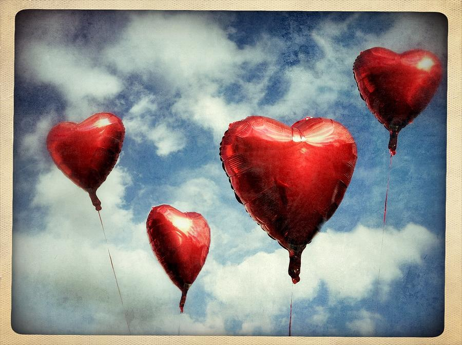 Four Red Heart Shaped Balloons Up In Air Photograph by Elineart