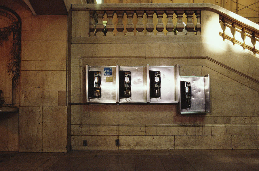 Four Telephone Booths On Marble Wall Photograph by Herb Schmitz