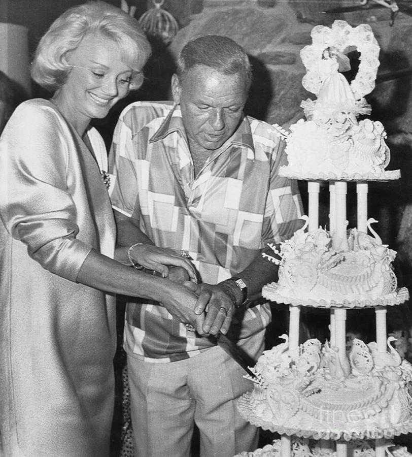 Frank Sinatra Cutting Wedding Cake Photograph by Bettmann