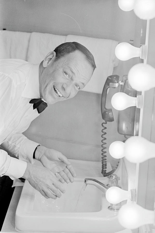 Frank Sinatra Washing His Face In His Photograph by John Dominis