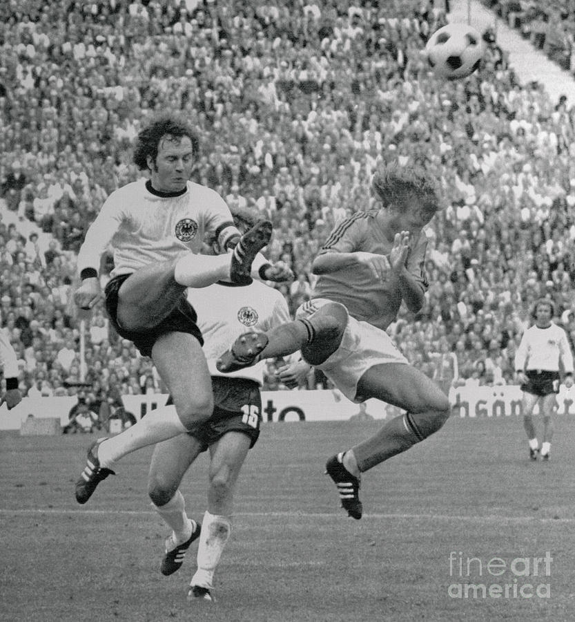 Franz Beckenbauer Kicking A Soccer Ball Photograph by Bettmann
